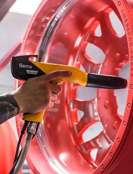Someone powder coating a wheel